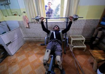 An Afghan amputee lifts weights at the International Committee of the Red Cross facility for war victims and the disabled in Mazar-i-Sharif. In September, a patient shot and killed a staffer, closing the center for a month and contributing to a decision