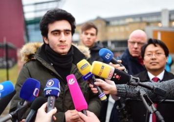 Anas Modamani speaks to the media Feb. 6 in Wuerzburg, Germany, after a court session about his lawsuit against Facebook. Modamani's suit, regarding the misuse of a selfie he took of himself with German Chancellor Angela Merkel was rejected, but his lawy
