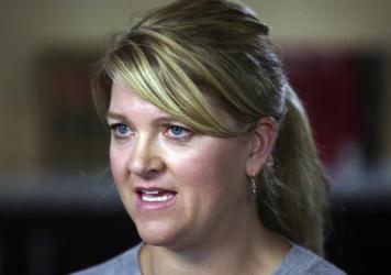 Alex Wubbels, the nurse who was arrested for refusing to let a police officer draw blood from an unconscious patient, has settled with Salt Lake City and the University of Utah for $500,000. Wubbels is shown here during an interview in September.