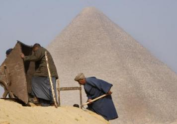 Archaeology workers toil in front of the Great Pyramid, in Giza, Egypt, in 2010. Researchers say they've discovered a new room inside the ancient structure.