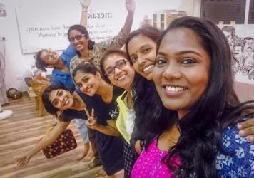 Sayanora Philip (foreground), a singer in Mollywood films, takes a selfie with fellow members of the newly formed Women in Cinema Collective.