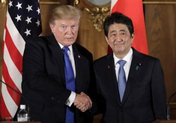 President Trump shakes hands with Japanese Prime Minister Shinzo Abe during a joint news conference at the Akasaka Palace on Monday in Tokyo.