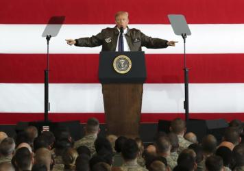 U.S. President Donald Trump delivers a speech to U.S. troops at the Yokota Air Base outside Tokyo on Sunday. Japan is the first stop on his five-nation trip.