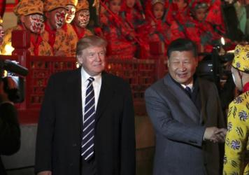 President Trump and Chinese President Xi Jinping arrive to watch an opera performance at the Forbidden City on Wednesday in Beijing.