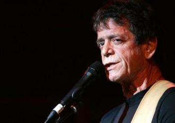 "Lou Reed performs in New York City in 2004. ""I wanted to write a book that took Lou ... seriously,"" says biographer Anthony DeCurtis."