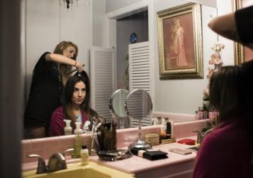 Claudia De La Vega has her hair done the night before her wedding.