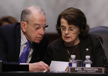 Senate Judiciary Committee Chairman Charles Grassley, R-Iowa, and ranking member Dianne Feinstein, D-Calif., participate in an executive business meeting in April. A party-line vote by the committee on Thursday advanced the judicial nomination of Brett T