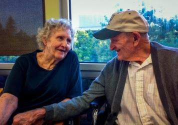 Gloria Single and her husband Bill Single in the dining hall of the skilled nursing floor at Pioneer House nursing home in Sacramento. AARP Foundation attorneys say California needs to more tightly enforce laws that prohibit evictions of the sort that se