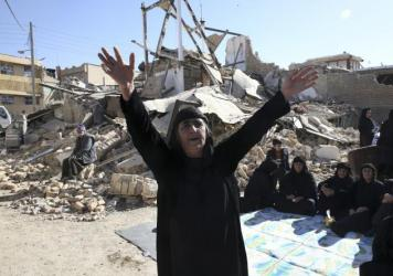 A woman mourns at an earthquake site in the Kurdish town of Sarpol-e Zahab in the western Iranian province of Kermanshah on Tuesday.