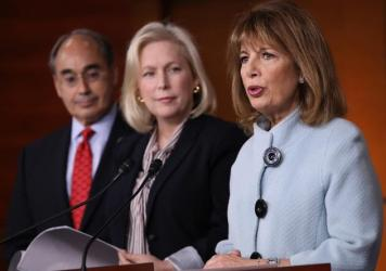 Rep. Jackie Speier, D-Calif. (right), Sen. Kirsten Gillibrand, D-N.Y., and Rep. Bruce Poliquin, D-Maine, speak at a press conference on sexual harassment in Congress on Wednesday in Washington, D.C.