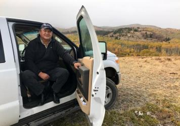 Blackfeet tribal council member Roland Kennerly sits at the edge of the Badger-Two Medicine area near the Blackfeet Reservation.