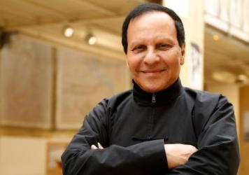 Franco-Tunisian fashion designer Azzedine Alaia poses during an exposition of Britain's artist Richard Wentworth photographic work on fashion design on Sept. 7, 2017 at the Maison Alaia in Paris.