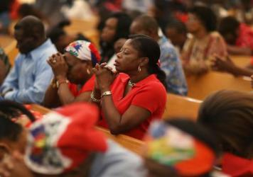 Parishioners pray together May 18 at the Notre Dame D'Haiti Catholic Church in the Little Haiti neighborhood of Miami. The prayer service touched on the church's concern about the outcome of the decision on extending the Temporary Protected Status for 50