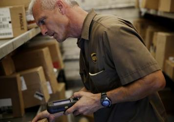 Rewarding customers when they choose slower shipping options is one way online retailers are reacting to a recent decision by UPS to add a holiday surcharge during peak delivery days.