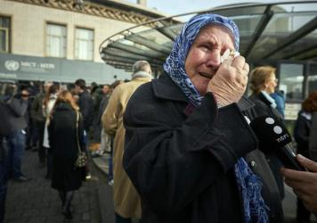 Nura Mustafic, one of the Mothers of Srebrenica, wipes away tears as she reacts to the verdict handed down against former Bosnian Serb military chief Ratko Mladic, in The Hague on Wednesday. Mladic was convicted of genocide and crimes against humanity and sentenced to life in prison for atrocities perpetrated during Bosnia's 1992-1995 war.
