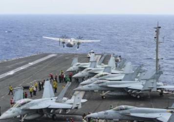 In this photo released by the U.S. Navy, Airman apprentice Bryan Grosso, assigned to USS Ronald Reagan is shown.