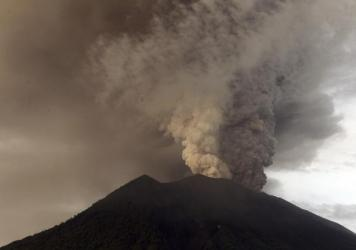 Another view of the Mount Agung volcano erupting in Karangasem, Bali, Indonesia, on Monday. Tens of thousands of people near the mountain are being evacuated.