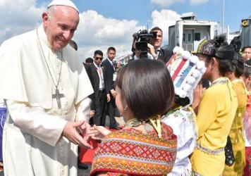 In this image provided by L'Osservatore Romano, Pope Francis arrives in Yangon, Myanmar, on Monday.