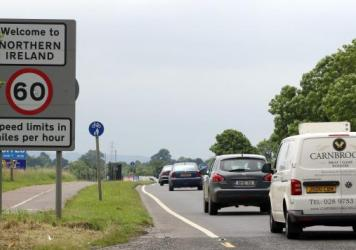 Cars cross the fluid border between Ireland and Northern Ireland in Donegal, Ireland, on June 25, 2016. The result of Britain's referendum vote to leave the European Union has ignited a debate over whether the border will need to establish customs checks