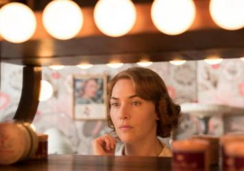 Kate Winslet as Ginny, a 1950s waitress on the verge of spinning out, in <em>Wonder Wheel. </em>