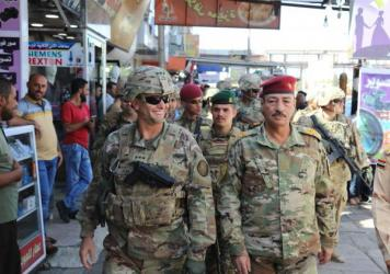 U.S. Army Lt. Gen. Paul Funk (left), and Iraqi Maj. Gen. Najm Abdullah al-Jibouri, walk through a busy market in Mosul, Iraq, on Oct. 4. U.S. forces in Iraq, Syria and Afghanistan have been increasing this year under President Trump, going from about 18,