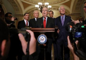 Republican Senate leaders, shown here speaking to reporters after the Republican Policy Committee luncheon at the Capitol Wednesday, are finalizing details of a tax plan they hope to vote on this week.
