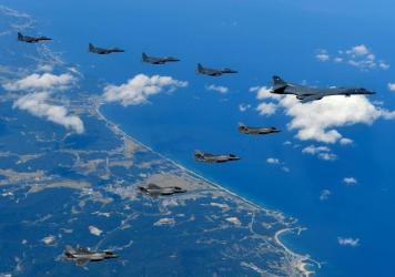 "A U.S. Air Force B-1B ""Lancer"" bomber flying with F-35B fighter jets and South Korean Air Force F-15K fighter jets during a training at the Pilsung Firing Range in South Korea in September."