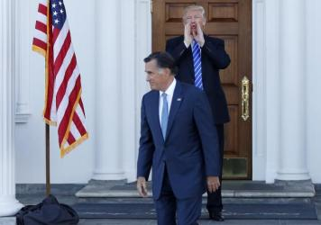 President-elect Donald Trump calls out to the media as Mitt Romney leaves Trump National Golf Club Bedminster in Bedminster, N.J., shortly after Election Day. Romney was under consideration for secretary of state at the time. Now, he's eyeing a Senate race in Utah.