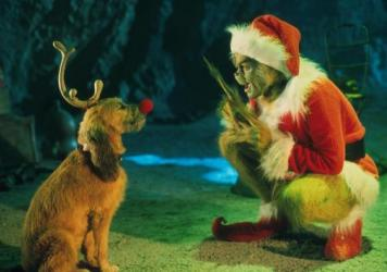 """The Grinch, played by Jim Carrey, conspires with his dog Max to deprive the Whos of their favorite holiday in the live-action adaptation of """"Dr. Seuss' How The Grinch Stole Christmas."""""""