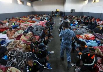 African migrants sitting in a shelter at the Tariq Al-Matar migrant detention center on the outskirts of the Libyan capital, Tripoli, on Monday.