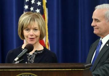 Democratic Gov. Mark Dayton holds a news conference in 2014 with running mate Tina Smith in St. Paul, Minn. Dayton has named Smith to take Al Franken's seat in the U.S. Senate.