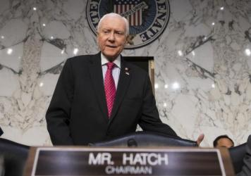 Senate Finance Committee Chairman Orrin Hatch, R-Utah, arrives as the tax-writing panel began work on overhauling the nation's tax code on Nov. 13.