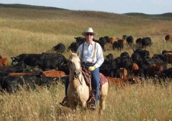 "James Dinklage, a cattle rancher from Nebraska, is one of the plaintiffs in a lawsuit filed Thursday. The suit accuses the USDA of ""arbitrary and capricious"" behavior in rolling back two Obama-era rules designed to protect small farmers, who say they are"