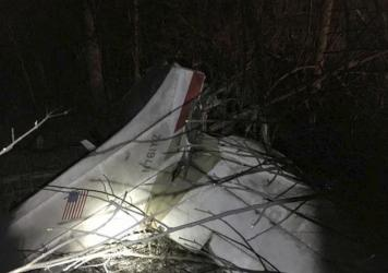A photo provided by the Indiana State Police shows the wreckage from a small plane crash Saturday night in southeastern Indiana. An executive at the NTSB was among the three people killed when the Cessna crashed into the woods.