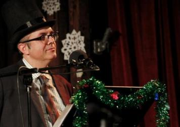 Puzzle Guru Ebeneezer Scrooge (played by Will Hines) on the Ask Me Another holiday special.