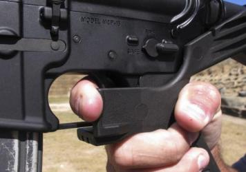 Bump stocks are now illegal to use in Columbia, S.C., after the city enacted a ban on the devices. In this photo from October, a shooting instructor shows the grip of an AR-15 rifle fitted with a bump stock.