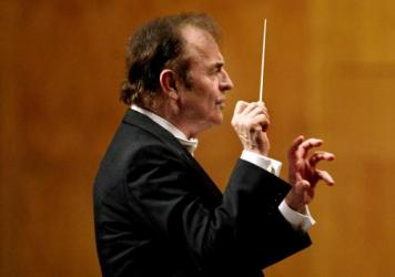 Charles Dutoit, conducting the Royal Philharmonic orchestra during a tour of Spain in 2006.
