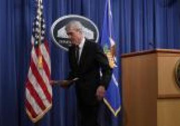 "Special counsel Robert Mueller leaves after making a statement about the Russia investigation on Wednesday at the Justice Department. After the investigation, he said, ""if we had had confidence that the president clearly did not commit a crime we would h"