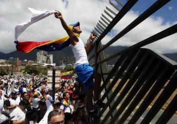 Supporters of Venezuelan opposition leader Juan Guaidó take part in a march in Caracas in February 2019. Amid Venezuela's isolation and catastrophic economic conditions, Guaidó emerged as a key challenger to Nicolás Maduro's rule, but has had difficul