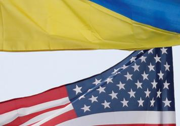 Ukrainian and U.S. flags fly in Kyiv, Ukraine.