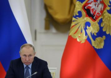 Russian President Vladimir Putin speaks during the State Council's meeting at Grand Kremlin Palace on Dec. 26 in Moscow.
