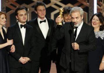 Sam Mendes accepts the award for best drama movie for <em>1917</em> at the Golden Globes on Sunday night.