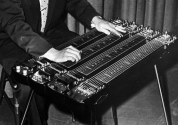 Rock pioneer Ernie Ball, photographed playing the pedal steel guitar in the late 1950s.