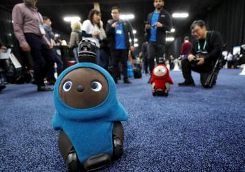 Lovot companion robots by Groove X wander at CES, the consumer electronics show, in Las Vegas.