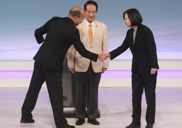 Taiwan's 2020 presidential candidates (from right), President Tsai Ing-wen of the Democratic Progressive Party, the People First Party's James Soong and the Nationalist Party's Han Kuo-yu, greet one another at the start of their televised debate in Taipe