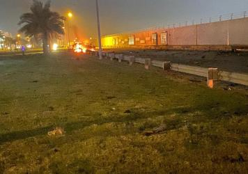 The remains of a burning vehicle at the Baghdad International Airport following an airstrike early Friday, Jan. 3, 2020. The Pentagon said Thursday that the U.S. military killed Gen. Qassem Soleimani, the head of Iran's elite Quds Force, at the direction