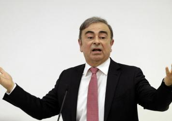 Former Nissan Chairman Carlos Ghosn addresses a news conference Wednesday in Beirut, during which he explained his reasons for dodging trial in Japan. The 65-year-old former auto executive, who is accused of financial misconduc, vowed to clear his name i