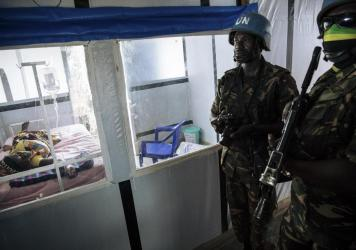 United Nations peacekeepers stand next to a patient during a visit of the U.N. secretary-general at an Ebola treatment center in Mangina, North Kivu province, last September.