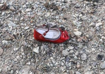 A child's shoe sits amid the rubble of the Ukrainian jetliner, which carried 176 people to their deaths when it plunged from the sky outside Tehran on Wednesday.