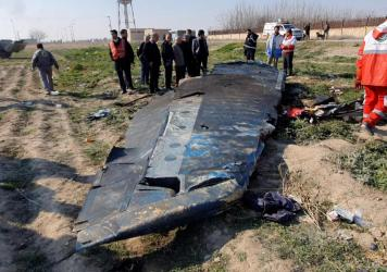 Debris from the Ukraine International Airlines flight 752, which was shot down after takeoff from Iran's Imam Khomeini airport, on the outskirts of Tehran.